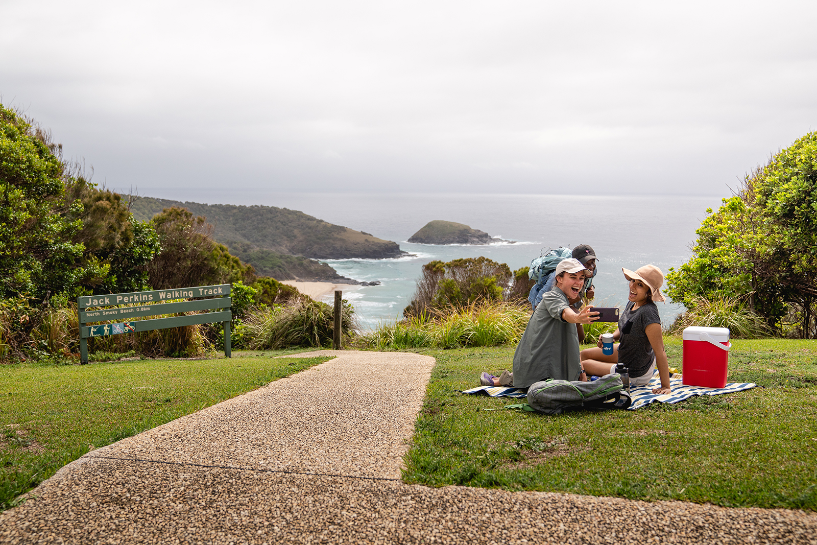 Group of people having a picnic near Jack Perkins walking track, Hat Head National Park. Photo: Rob Mulally/DPIE
