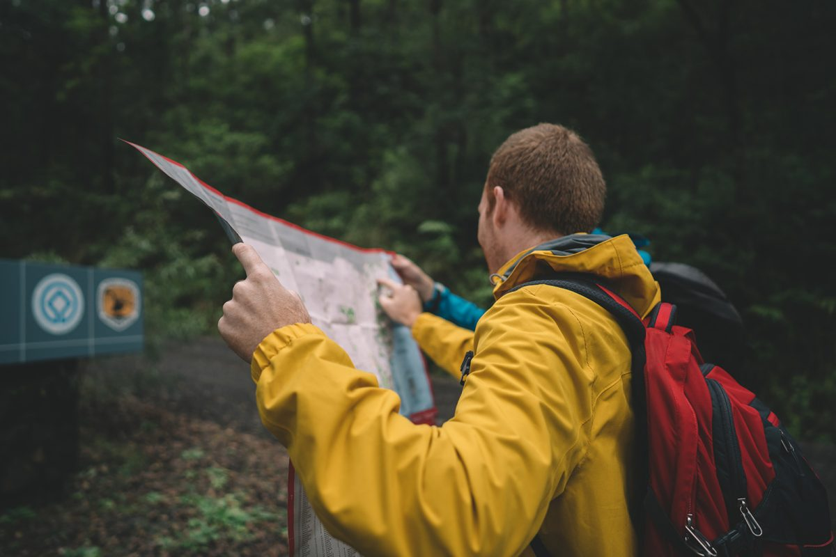 A guy looking at a map in Border Rangers National Park