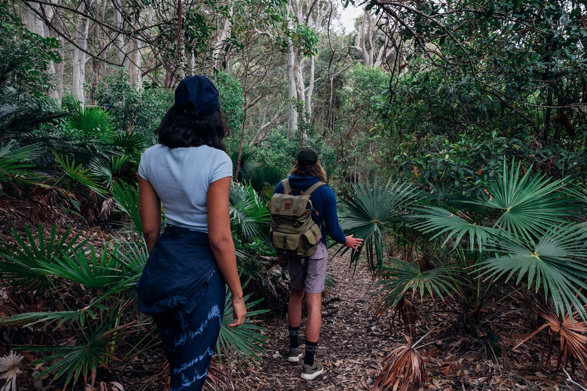 Two people on a walk in Murramarang National Park