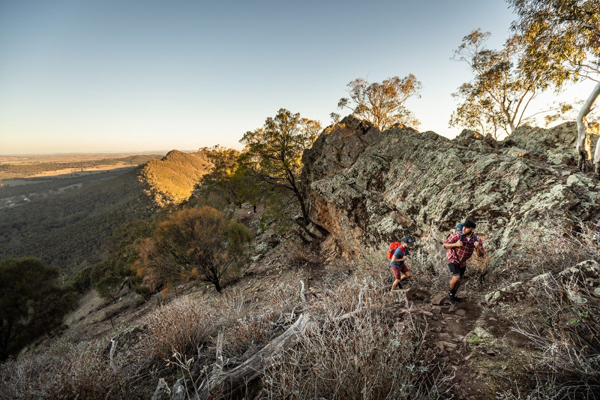 Two people hiking along the Yerong walking track, The Rock Nature Reserve - Kengal Aboriginal Place. Photo: Rob Mulally/DPIE