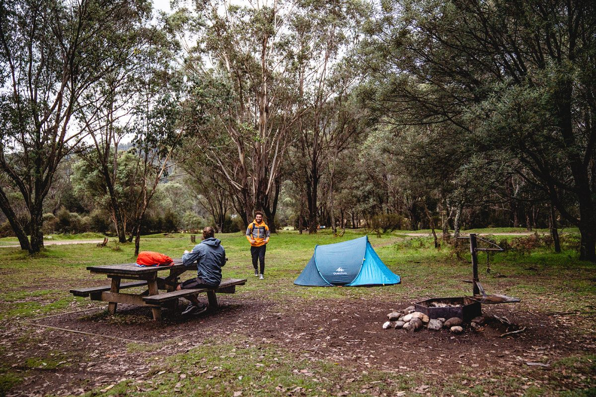 Two guys greeting each other at Geehi Flats campground, Khancoban area in Kosciuszko National Park. Photo: Rob Mulally/DPIE