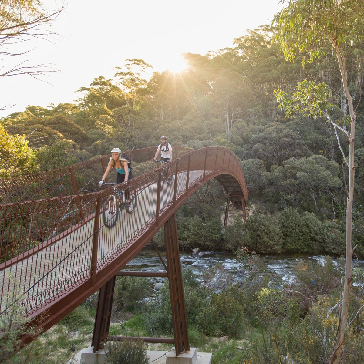 Two people riding on Bridge 5, Thredbo Valley track, Thredbo-Perisher area in Kosciuszko National Park. Photo: Boen Ferguson/DPIE