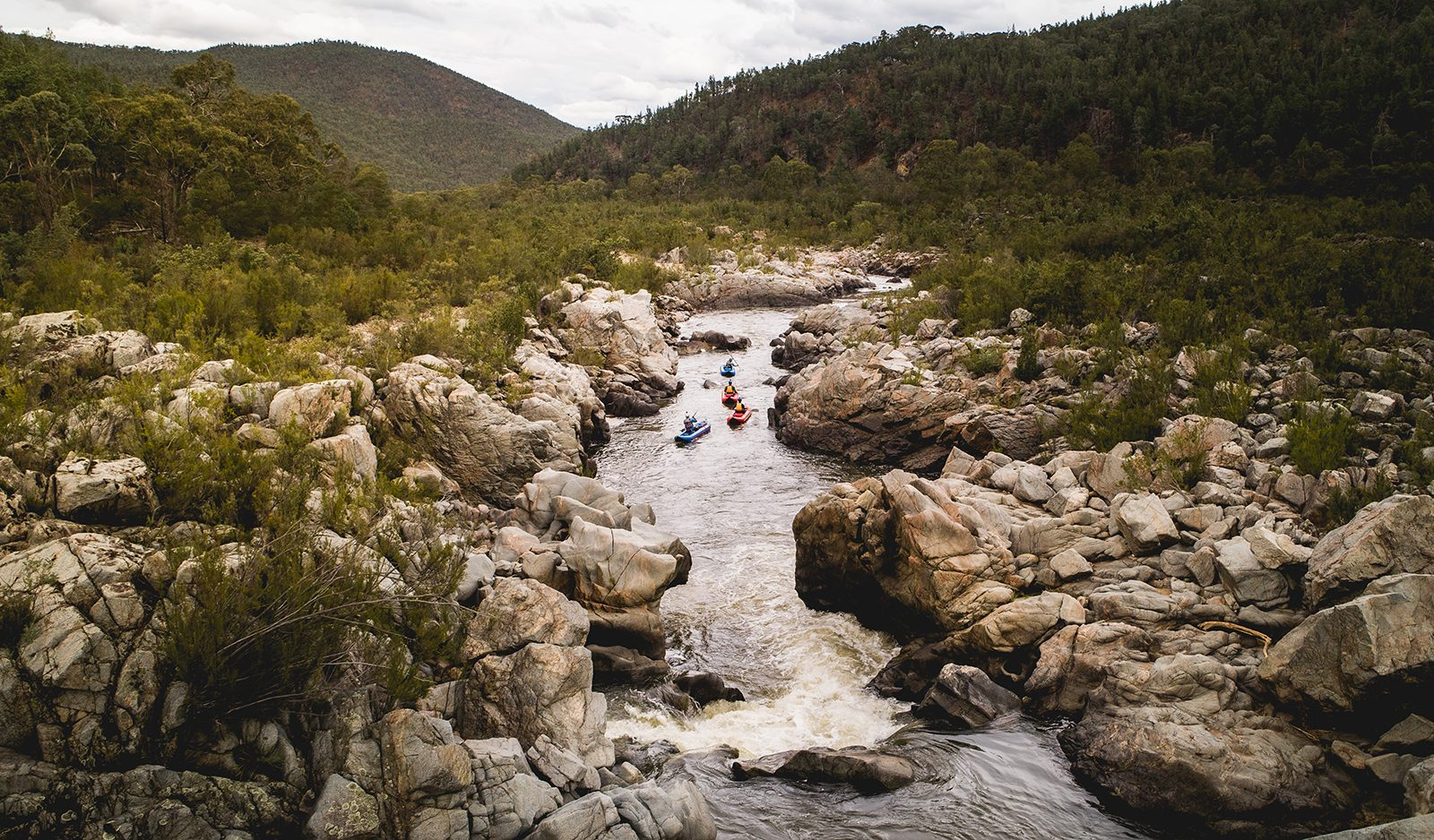 Aerial view of four people kayaking on the Snowy River, Kosciuszko National Park. Photo: Rob Mulally/DPIE