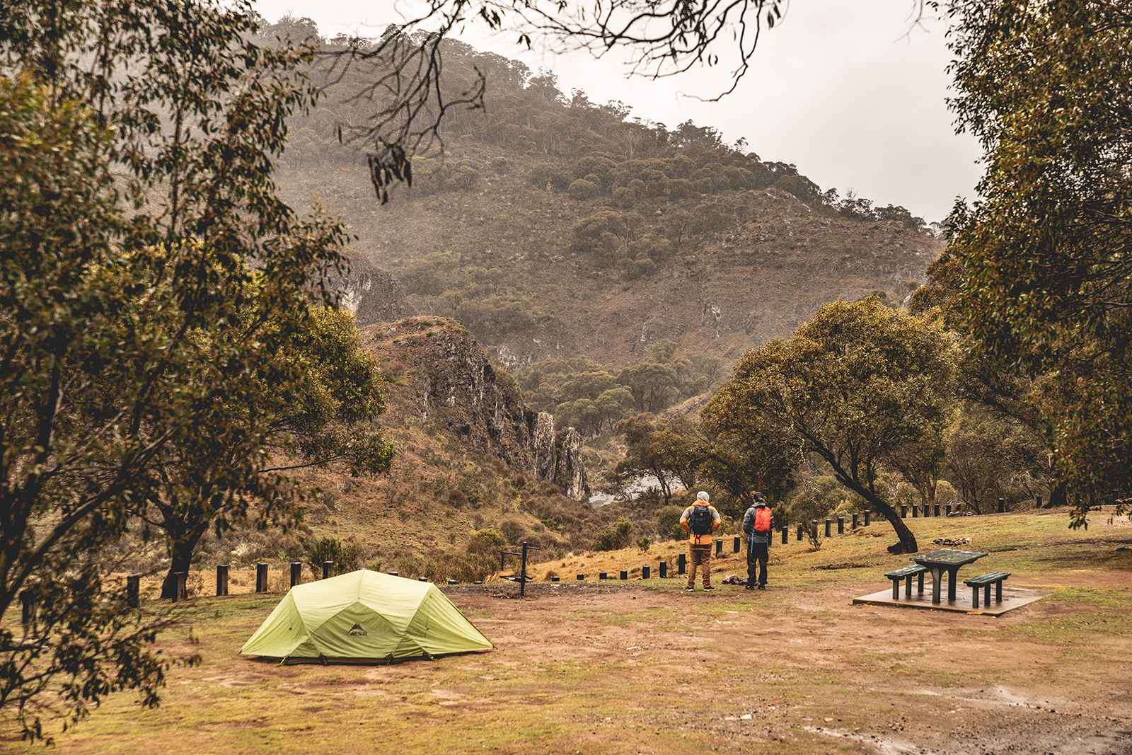 Two people looking at Clarke Gorge from Blue Waterholes campground, High Plains area in Kosciuszko National Park. Photo: Rob Mulally/DPIE