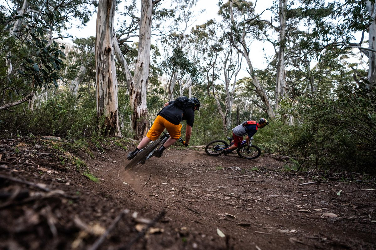 Two guys tackling switchbacks between Ngarigo and Thredbo Diggings campground on the Thredbo Valley Track