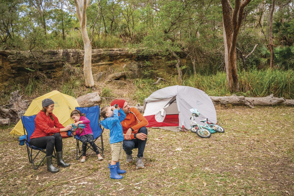 A family of four birdwatching, Bonnie Vale Campground, Royal National Park. Photo: John Spencer/DPIE