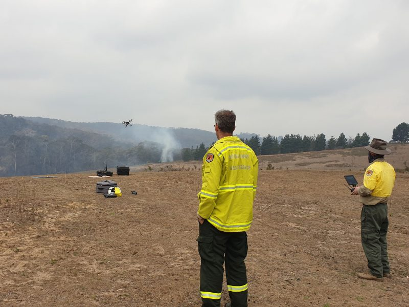 Drone pilots working in pairs. Launch and land drones from the fireground. Photo: Scott Colefax / DPIE