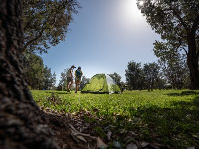 Two people near a tent in a NSW national park. Photo: Rob Mulally / DPIE